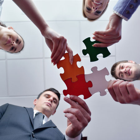 Business putting jigsaw puzzle together